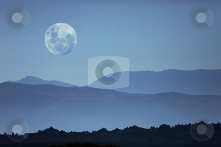 Ghostly Mountain Silhouettes and Moon stock photo, Beautiful Ghostly Mountain Silhouettes and Moon Moonscape by Katrina Brown