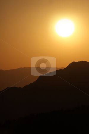 Vertical Silhouette Sunrise of Hazy Misty Mountains stock photo, Vertical Silhouette Sunrise of Hazy Misty Mountains With Warm Colors by Katrina Brown