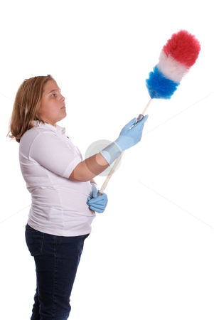 Dusting Girl stock photo, A young girl using a long duster to clean with, isolated against a white background by Richard Nelson