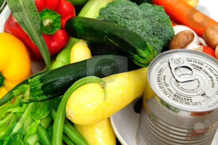 Canned Soup stock photo, Can of soup in a bowl surrounded by fresh vegetables by Lynn Bendickson