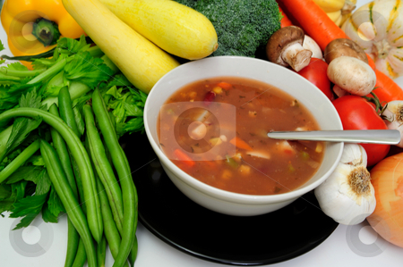 Vegetable soup  stock photo, Hot vegetable soup with a sprig of basil served in a white bow by Lynn Bendickson