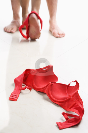 Couple having intercourse with red bra on floor stock photo, Couple having intercourse with red bra on floor, I use red color so it can be used to support AIDS cause. PS: focus on bra by Rudyanto Wijaya