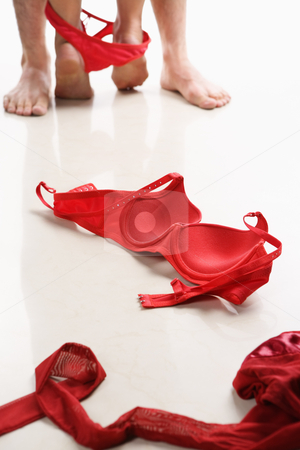 Couple with red underwear on floor stock photo, Couple with red underwear on floor by Rudyanto Wijaya