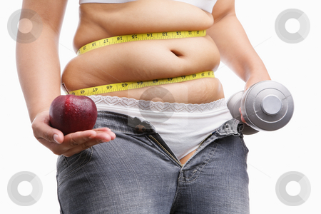 Fat woman with unzup jeans holding apple and weight on each hand stock photo, Fat woman with unzup jeans holding apple and weight on each hand, id a concept to fight against obesity by Rudyanto Wijaya