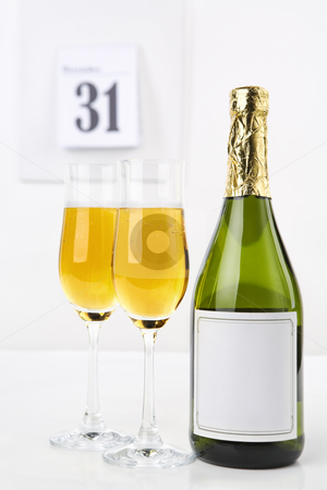 Champagne on new year eve stock photo, Champagne on new year eve with calendar on background by Rudyanto Wijaya