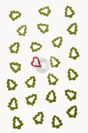 Representing Xmas stock photo, Ornamental heart between fir-trees on white background representing Christmas. by Roberts Ratuts