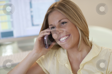 Young Woman on Phone stock photo, Close-up of smiling young woman using the phone. Horizontal format. by Edward Bock