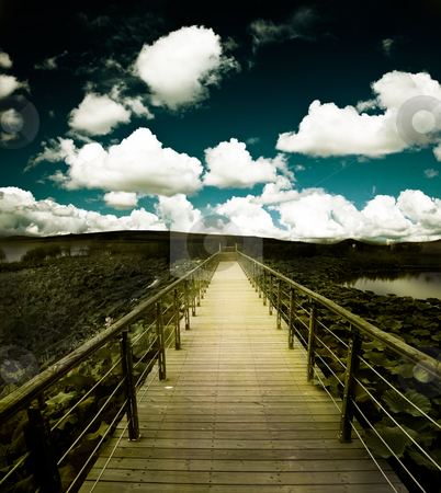 Bridge stock photo, Bridge of a lake with the cloud background. by Yuanyuan Xie