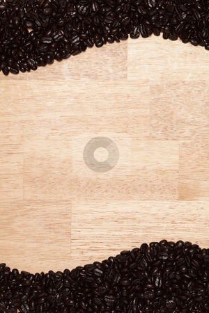 Dark Roasted Coffee Beans on Wood Background stock photo, Dark Roasted Coffee Beans on a Wood Textured Background. by Andy Dean