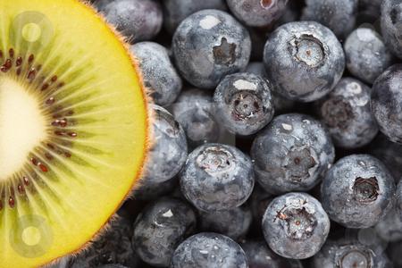 Macro Kiwi and Blueberries stock photo, Macro Kiwi and Blueberries Background with Copy Space. by Andy Dean
