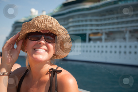 Beautiful Vacationing Woman with Cruise Ship stock photo, Beautiful Vacationing Woman on Tender Boat with Cruise Ship in the Background. by Andy Dean