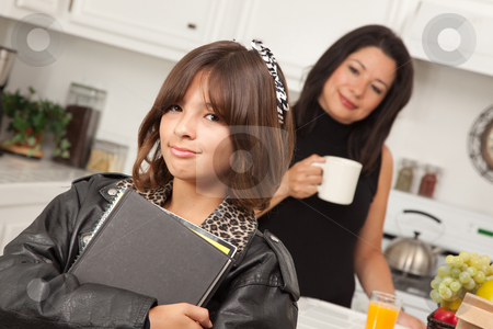 Pretty Hispanic Girl Ready for School stock photo, Pretty Hispanic Girl Ready for School with Mom in the Background. by Andy Dean
