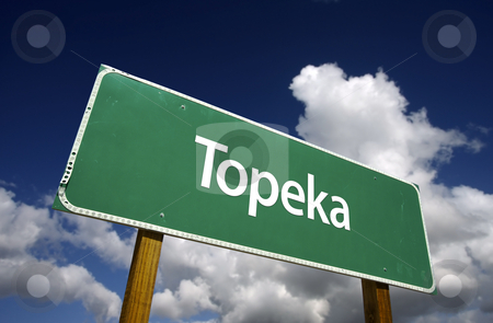 Topeka Green Road Sign stock photo, Topeka Road Sign with dramatic blue sky and clouds - U.S. State Capitals Series. by Andy Dean