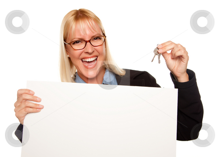 Attractive Blonde Holding Keys and Blank White Sign stock photo, Attractive Blonde Holding Keys and Blank White Sign Isolated on a White Background. by Andy Dean