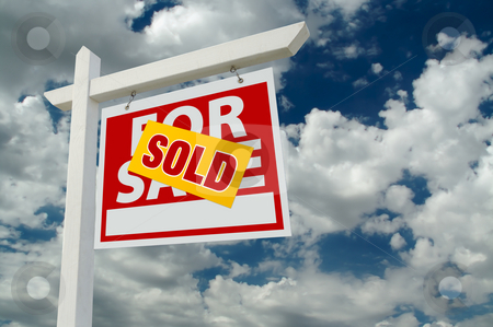 Sold For Sale Real Estate Sign on Clouds stock photo, Sold For Sale Real Estate Sign on Cloudy Sky. by Andy Dean