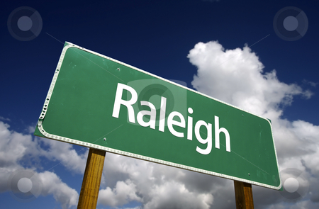 Raleigh Green Road Sign stock photo, Raleigh Road Sign with dramatic blue sky and clouds - U.S. State Capitals Series. by Andy Dean