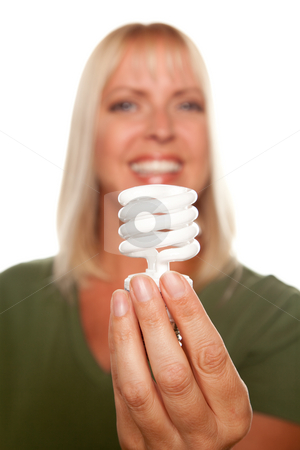Attractive Blonde Woman Holds Energy Saving Light Bulb stock photo, Attractive Blonde Woman Holds Energy Saving Light Bulb Isolated on a White Background with Narrow Depth of Field. by Andy Dean