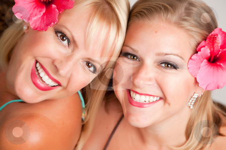Beautiful Smiling Girls with Hibiscus Flowers stock photo, Beautiful Smiling Girls with Hibiscus Flowers in Their Hair. by Andy Dean