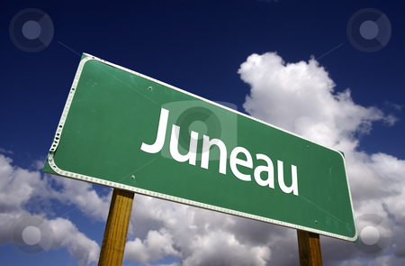 Juneau Green Road Sign stock photo, Juneau Road Sign with dramatic blue sky and clouds - U.S. State Capitals Series. by Andy Dean