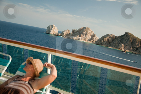 Beautiful Woman Relaxes on a Cruise Ship Deck stock photo, Beautiful Woman Relaxes on a Cruise Ship Deck at Land's End in Cabo San Lucas, Mexico. by Andy Dean