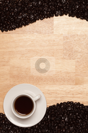 Dark Roasted Coffee Beans on Wood Background stock photo, Dark Roasted Coffee Beans and Cup with Saucer on a Wood Textured Background. by Andy Dean