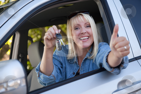 Attractive Woman In New Car with Keys stock photo, Attractive Happy Woman In New Car with Keys. by Andy Dean