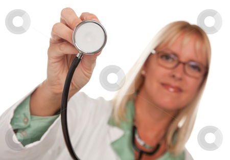 Attractive Female Doctor Holding Stethoscope stock photo, Attractive Female Doctor Holding Stethoscope Isolated on a White Background. by Andy Dean
