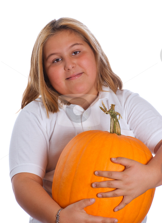 Girl Holding Pumpkin stock photo, A young girl holding a heavy and large pumpkin, isolated against a white background by Richard Nelson