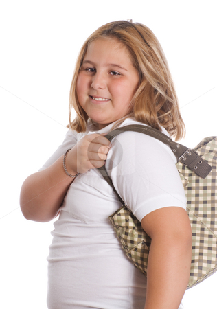 Girl Holding Purse stock photo, A young girl holding a purse over her shoulder, isolated against a white background by Richard Nelson