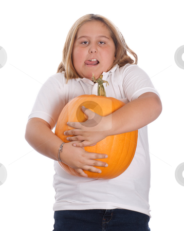Girl Holding Large Pumpkin stock photo, A young girl holding a heavy and large pumpkin, isolated against a white background by Richard Nelson