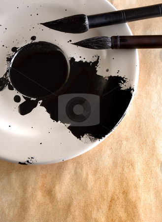 Brushes stock photo, Liquid China ink in the saucer with two calligraphy brushes by Vladimir Semenov