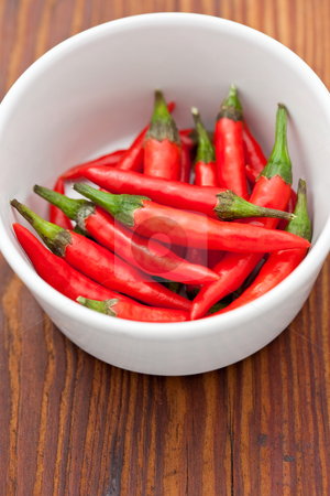 Small red chili peppers stock photo, Small red chili peppers in a dish by Robert Anthony