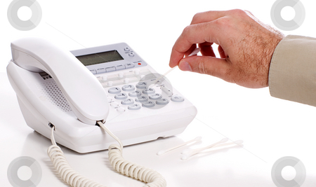 Disinfecting stock photo, Someone disinfecting a telephone with a cotton swap, shot on white by Richard Nelson