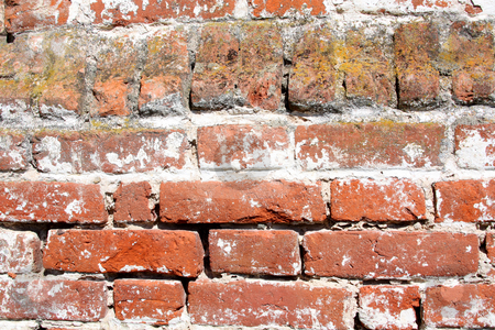 Old wall of red brick stock photo, Old wall of red brick, sunlit. Grunge background by Olga Lipatova
