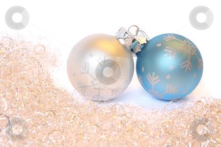 Christmas balls and a tinsel stock photo, Two Christmas balls and golden tinsel. Isolated on white by Olga Lipatova