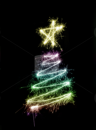 Sparkling Xmas Tree stock photo, A colourful christmas tree symbol drawn in sparkler trails by Stephen Gibson