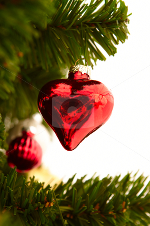 Christmas - Red heart decoration on white stock photo, Christmas - Red heart ornament on white by Phillip Dyhr Hobbs