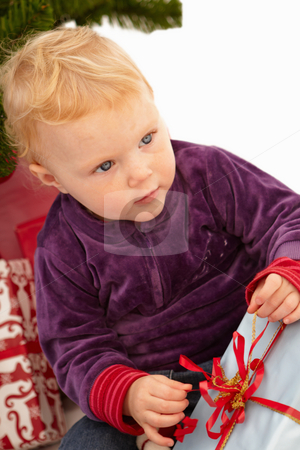 Christmas - Cute child opening presents stock photo, Christmas - Cute child opening presents on x-mas day by Phillip Dyhr Hobbs