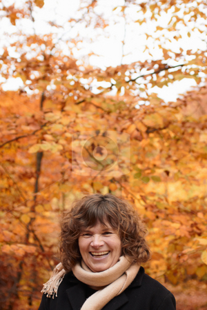 Autumn - happy middle aged woman laughing stock photo, Autumn - Joyful middle aged woman laughing by Phillip Dyhr Hobbs