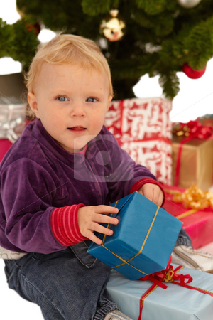 Christmas - child opening x-mas gifts stock photo, Christmas - child opening x-mas presents by Phillip Dyhr Hobbs
