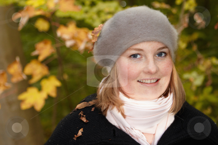 Fall - Cute pretty woman smiling  stock photo, Autumn - Cute pretty woman smiling by Phillip Dyhr Hobbs