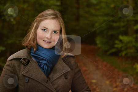Freindly young woman standing by a forest path stock photo, Freindly young woman standing by a  path in the forest by Phillip Dyhr Hobbs