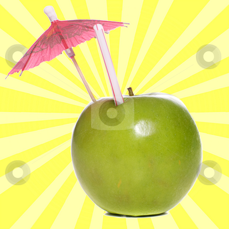 Apple Juice stock photo, Concept image of fresh apple juice featuring an apple with a straw and an umbrella in it by Richard Nelson