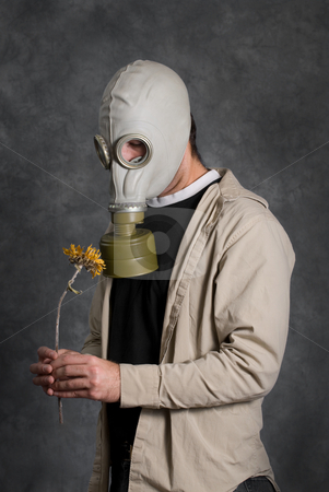 Death stock photo, Concept image of death featuring a young man wearing a gas mask and holding a wilted flower by Richard Nelson
