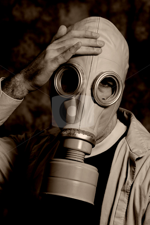 Disaster stock photo, A dark image featuring someone wearing a gas mask holding his head by Richard Nelson