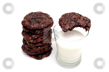 Chocolate Cookies And Milk stock photo, Rich dark chocolate cookies and a glass of cold milk. One cookie has a bite out of it by Lynn Bendickson