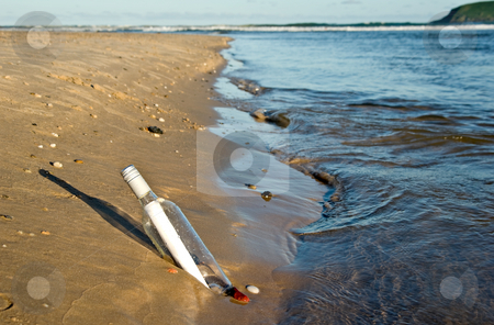 Message in a bottle stock photo, Great image of a message in a bottle at the waters edge by Phil Morley