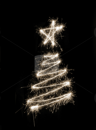 Sparkling Xmas Tree stock photo, A christmas tree symbol drawn in sparkler trails by Stephen Gibson