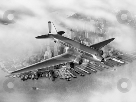 DC-3 Over NYC stock photo, Vintage image of a Douglas DC-3 over New York City by James Steidl