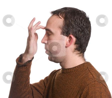 EFT Forehead stock photo, A man wearing a sweater is doing the